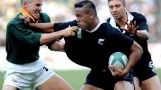 New Zealand winger Jonah Lomu attempts to push off South Africa's James Small (left) as Glen Osborne (right) runs in during the final of the 1995 Rugby World Cup at Ellis Park in Johannesburg, South Africa, on June 24, 1995. File picture: Mark Baker