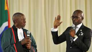 New minister of home affairs Malusi Gigaba is sworn in at a ceremony in Pretoria on Monday, 26 May 2014. With him is Deputy Chief Justice Dikgang Moseneke. Picture: GCIS/SAPA