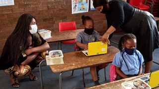 North West Education MEC Mmaphefo Matsemela watches how a teacher engages with a pupil using a laptop.PICTURE: SUPPLIED.