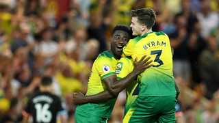 Norwich City's Alexander Tettey and Sam Byram celebrate at the final whistle after their English Premier League match against champions Manchester City at Carrow Road, Norwich on Saturday. Photo: Joe Giddens/AP