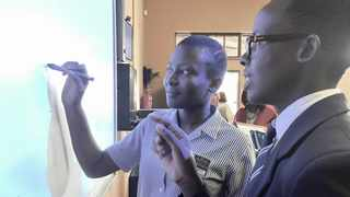 Nosipho Nkosi and Melikhaya Jacobs get to grips with the new Ligbron e-learning system at Shea O'Connor Combined School near Nottingham Road. The award-winning system incorporates the use of SMART boards and offers access to specialist maths and science teachers. Picture: Bernadette Wolhuter