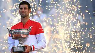 Novak Djokovic poses with The Mousquetaires Cup (The Musketeers) after winning the French Open. Photo: Anne-Christine Poujoulat/AFP