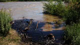 Oil swirls in a flooded gravel pit in Lockwood, Montana. The Exxon Mobil pipeline that runs under the Yellowstone River near Billings, in south-central Montana, ruptured and dumped an unknown amount of oil into the waterway, prompting temporary evacuations along the river.