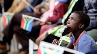 PATRIOT: A boy holds a flag as South Africa's President Jacob Zuma addresses the National Youth Day. A reader remarks that the ANC had a hand in designing the SA flag. Picture: Reuters