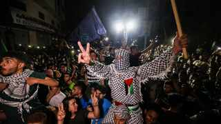 Palestinians celebrate in the streets following a ceasefire brokered by Egypt between Israel and the ruling Islamist movement Hamas in the Gaza Strip on Friday. Picture: AFP