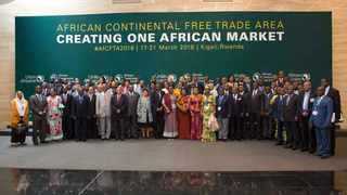 Participants pose for group photo during a meeting of the Permanent Representatives Committee of the AU in Kigali, Rwanda, in March 17. An agreement to launch the African Continental Free Trade Area (AfCFTA) was signed here. Photo: Xinhua