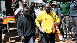 Pastor and activist Evan Mawarire right, will ask the High Court to free him on bail after his detention on subversion charges. Picture: AP Photo/Tsvangirayi Mukwazhi
