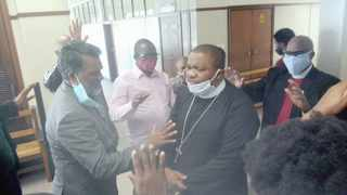 Pastors praying for Bishop Bheki Ngcobo when he appeared in the Durban Magistrate's Court on Friday. Nkululeko Nene