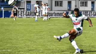 Pau's Elton Jantjies kicks at goal during their French Top 14 rugby union match against SU Agen at the Armandie Stadium in Agen. Photo: Thierry Breton/AFP