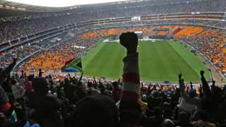 People cheer as US President Barack Obama speaks at the First National Bank (FNB) Stadium during the national memorial service for Nelson Mandela in Johannesburg. REUTERS/Yves Herman