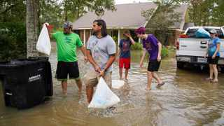 People clean up a flooded home in Ponchatoula, Louisiana. Tropical Storm Ida made landfall as a Category 4 hurricane in Louisiana and brought flooding and wind damage along the Gulf Coast. Picture: Sean Rayford/Getty Images/AFP
