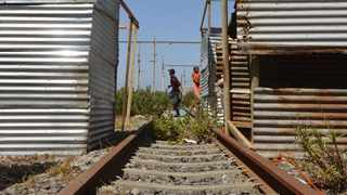 People have built shacks in between train tracks in Cape Town. Photo: Tracey Adams/African News Agency