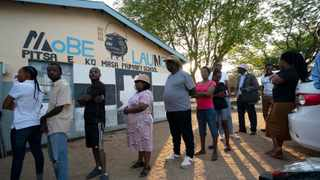 People line up to vote in Botswana's general elections at the Masa primary school in Gaborone. Polls opened in Botswana on Wednesday as the long-peaceful southern African nation faces what is expected to be its tightest election in history. Picture: Jerome Delay/AP
