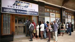 People queue outside a bank in Harare, Zimbabwe. Picture: Reuters/Mike Hutchings