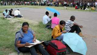 People standing in a long queue to apply for jobs. Picture: Sarah Makoe