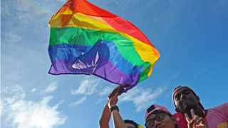 People wave a rainbow flag during the Pink Dot event in Singapore's Hong Lim Park in support of lesbian, gay, bisexual and transexual (LGBT) people. File picture: Then Chih Wey/Xinhua