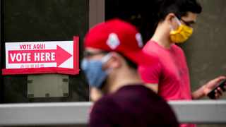 People wear masks as they wait in line to vote at a voting center during primary voting in Washington. Picture: Andrew Harnik/AP/African News Agency (ANA)