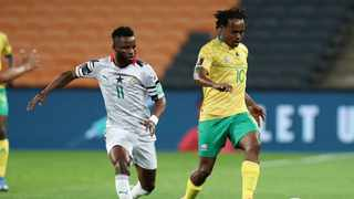 Percy Tau of South Africa challenged by Mubarak Wakaso of Ghana during their recent 2022 World Cup qualifier. Photo: Muzi Ntombela/BackpagePix