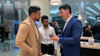 Philip Morris South Africa's Managing Director Hugo Marcelo Nico explains how the heated tobacco product IQOS works as Phillip Morris launches its first flagship boutique store in Sandton. Photo: Reuters.