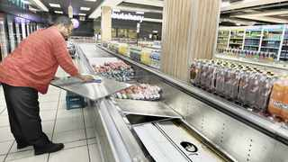 Phillip Monjane, an employee at the SuperSpar in Rosettenville, cleans a refrigerator after products from Enterprise Foods and RCL Foods were removed. Picture: Simphiwe Mbokazi/African News Agency (ANA)