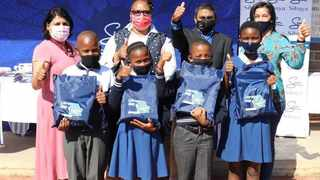 Pictured (left to right): Neesha Chetty, representative from the Department of Education; principal of Siphosethu Primary School Zaba Gumede Luthuli; Myan Moodley, Sibaya general manager and Karen Hammond, Sibaya HR manager, with a group of excited pupils from the school.