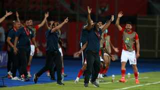 Pitso Mosimane, coach of Al Ahly, and his bench react to a decision during their CAF Champions League semi-final second leg against Esperance. Picture: BackpagePix