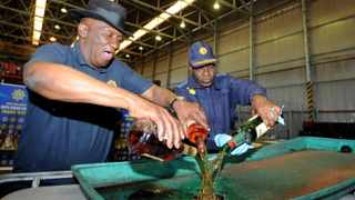 Police Minister Bheki Cele and National commissioner Khehla Sitole destroying liquor in Belhar Cape Town. Picture: Ayanda Ndamane African News Agency (ANA)
