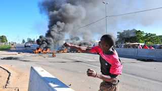 Police fired rubber bullets at a group of protesting residents who had blocked off Beyers Naude drive near Honeydew. Residents of Zandspruit informal settlement blocked the busy road, in a protest related to service delivery. The protest started shortly before 6am and the residents threw stones and burning tyres on Beyers Naude drive and Peter road. Photo: Steve Lawrence, The Star