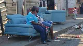 Police have recovered a range of items looted in KZN last week but the search is on for the blue sofa taken from a luxury furniture store in Springfield, valued at R70 000. Picture: Twitter