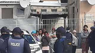 Police in Belhar at the scene of the latest fatal shooting incident, said to be close to the house that's causing nightmares for residents living in Winter Place, Selfhelp, in Belhar. Picture: Supplied