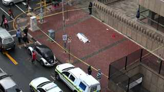 Police received a call from anonymous person informing them about a body lying on the corner of Helen Joseph and Pixley ka Seme streets near ANC headquarters, Luthuli House. Picture: Nhlanhla Phillips