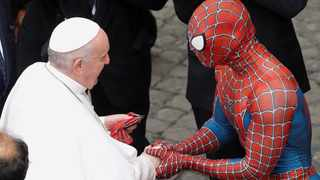 Pope Francis greets a person dressed as Spider-Man after the general audience. Picture: Remo Casilli/Reuters