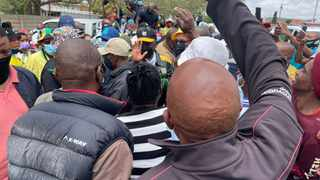 President Cyril Ramaphosa is flanked by community members as he arrives at the Methodist Church in ward 13 in Tlokwe in the North West. Ramaphosa's visit is part of the ANC's election campaign ahead of the November 1 local government elections Picture: Ntombi Nkosi/IOL Politics