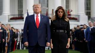 President Donald Trump and first lady Melania Trump on the South Lawn of the White House. Picture: Evan Vucci/AP