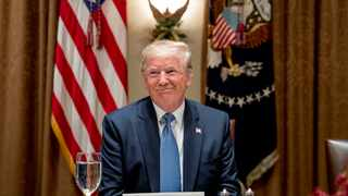 President Donald Trump smiles during a luncheon with members of the United Nations Security Council in the Cabinet Room at the White House in Washington. Picture: Andrew Harnik/AP
