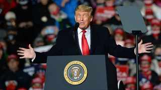 President Donald Trump speaks to supporters at the Erie International Airport in Millcreek Township in October 2020. Picture: Richard Hanrahan/Erie Times News via Reuters