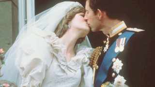 Prince Charles kisses Princess Diana on the balcony of Buckingham Palace in London on their wedding day in July 29, 1981. Picture: AP