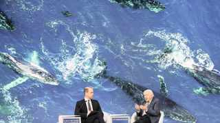 Prince William listens to Sir David Attenborough during a session at the World Economic Forum in Davos, Switzerland.
