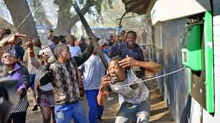 Protest action in Newclare trainstation turned violent as protesters vandalize railway property, police had to be called in to try and quell the situation which became more violent. Picture: Antoine de Ras, 06/10/2014