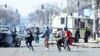 Protesters burn cars and looted shops in Jules Street in Jeppestown. Picture: Itumeleng English/African News Agency (ANA)
