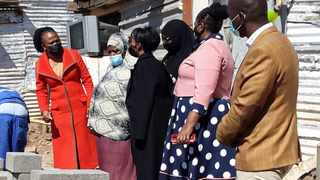 Public protector Busisiwe Mkhwebane, left, visits the Mhlahla family whose house was illegally demolished by the Red Ants. Picture: Rapula Moatshe