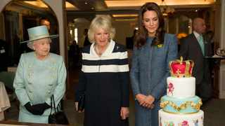 QUEEN Elizabeth, Camilla Duchess of Cornwall, and Catherine Duchess of Cambridge, admire a Jubilee cake at the Fortnum & Mason food store in London. REUTERS/Leon Neal/POOL
