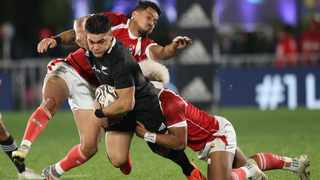 Quinn Tupaea tries to get away from Tongan defenders during their Test match. Picture: Michael Bradley/AFP