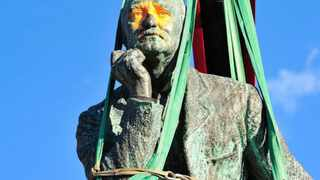 REMOVAL: The Cecil John Rhodes statue at the UCT campus wrapped in green industrial straps as its being prepared to be moved from its current location. Photo: HENK KRUGER
