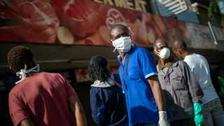 RESIDENTS of Yeoville in Johannesburg queue to enter a grocery store on March 28, 2020. South Africa went into a nationwide lockdown in an effort to control the spread of the coronavirus. (AP Photo/Jerome Delay)