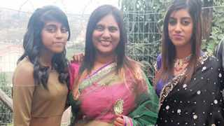 Rackelle and Denisha Govindasamy with their mother, Jane. An expert has testified that Denisha's legs had been folded and her body squashed into a wardrobe so it could fit. Picture: Supplied