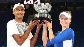 Rajeev Ram of the US and Czech Republic's Barbora Krejcikova pose with the trophy after winning their mixed doubles final against Australia's Matthew Ebden and Samantha Stosur. Photo: Kelly Defina/Reuters