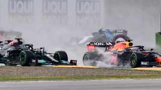 Red Bull's Dutch driver Max Verstappen (R) drives ahead of Mercedes' British driver Lewis Hamilton (L) during the Emilia Romagna Formula One Grand Prix at the Autodromo Internazionale Enzo e Dino Ferrari race track in Imola, Italy, on April 18, 2021. (Photo by Miguel MEDINA / AFP)