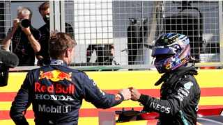Red Bull's Dutch driver Max Verstappen () and Mercedes' British driver Lewis Hamilton (R) bump fists after the sprint session of the Formula One British Grand Prix at Silverstone. Photo: Adrian Dennis/AFP