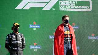 Red Bull's Max Verstappen celebrates on the podium after winning the race with Mercedes' Lewis Hamilton finishing second. Photo: Piroschka Van De Wouw/Reuters